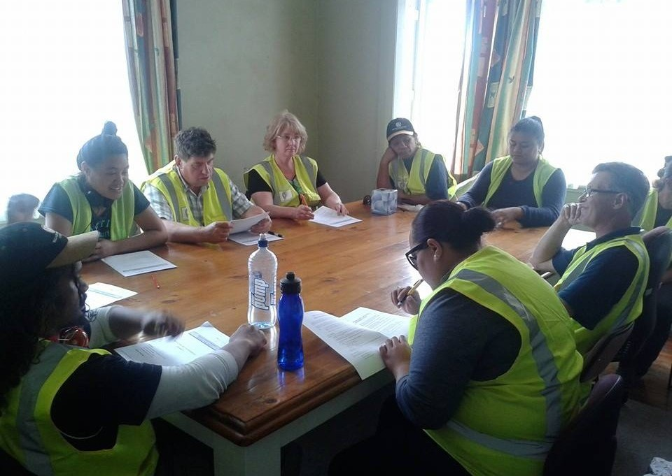 An image of a team completing a theory assessment.