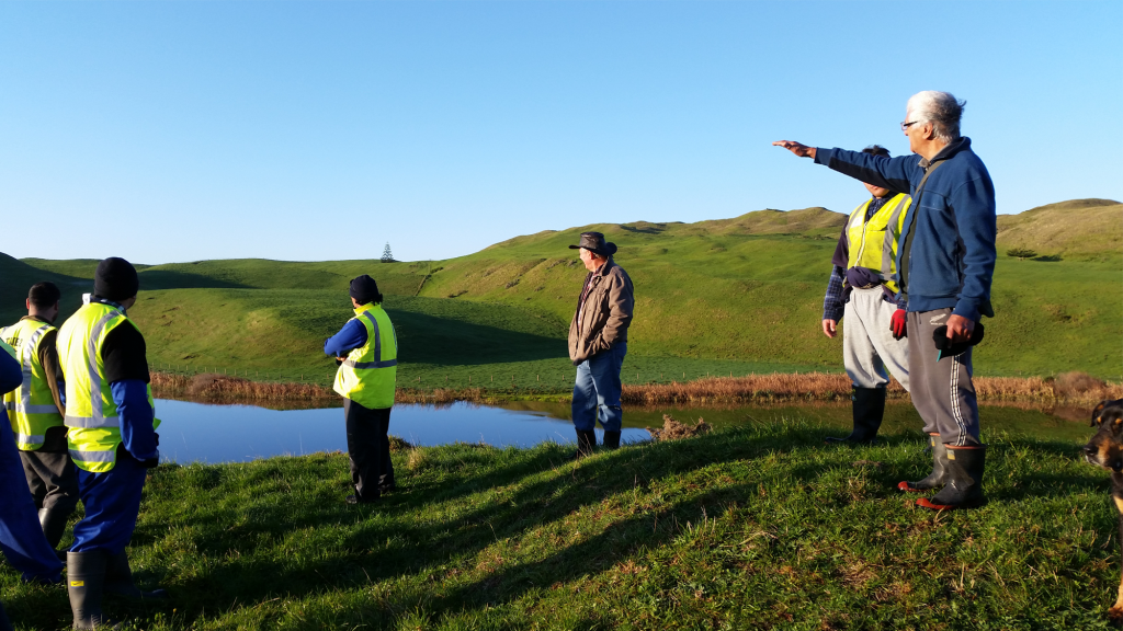 An image of local kaumatua telling the history of the planting site.